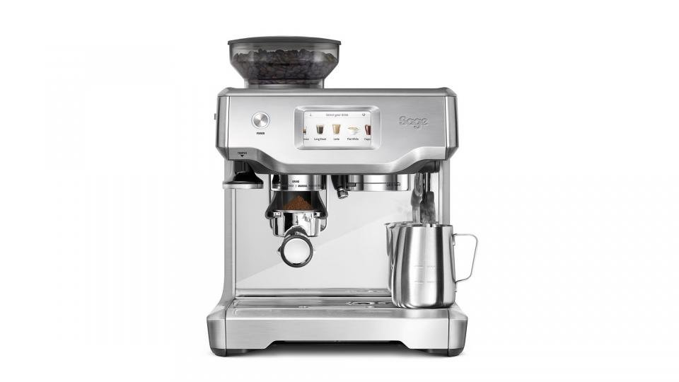 coffee cup latte art placed on coffee maker machine steam in..